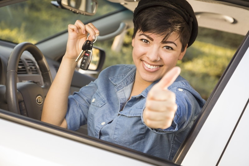 4043943-happy-mixed-race-woman-in-car-holding-keys
